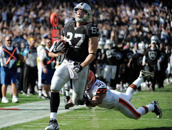Kevin Boss Kevin Boss #87 of the Oakland Raiders scores on a thirty-seven yard pass play beating Chris Gocong #51 of the Cleveland Browns to the endzone in the third quarter of an NFL football game O.co Coliseum on October 16, 2011 in Oakland, California.