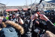 A large scrum of media follow the SUV carrying actor Kevin Spacey after he was arraigned on sexual assault charges at Nantucket District Court on January 7, 2019 in Nantucket, Massachusetts.