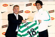 South Korean footballer Ki Sung-Yueng holds his new jersey with Chief Executive of Celtic Peter Lewell during a press conference announcing he will be joining Glasgow Celtic  at Nike Korea on December 21, 2009 in Seoul, South Korea. Ki Sung-Yueng, has agreed a contract for up to four years with the club and will join Celtic on January 1, 2010.
