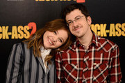 """Actors Chloe Grace Moretz and Christopher Mintz Plasse attend the """"Kick-Ass 2"""" Photocall at Claridges Hotel on August 5, 2013 in London, England."""