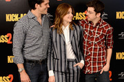 """Director Jeff Wadlow and actors Chloe Grace Moretz and Christopher Mintz Plasse attend the """"Kick-Ass 2"""" Photocall at Claridges Hotel on August 5, 2013 in London, England."""