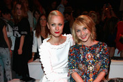 Franziska Knuppe and Anna Maria Muehe attend the Kilian Kerner show during the Mercedes-Benz Fashion Week Spring/Summer 2015 at Erika Hess Eisstadion on July 8, 2014 in Berlin, Germany.