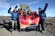 IMAGES AVAILABLE FREE OF CHARGE FOR EDITORIAL USE FOR 48 HOURS FROM CREATE DATE) (STRICTLY EDITORIAL USE ONLY)  (L-R) Alexander Armstrong, Osi Umenyiora, Shirley Ballas, Ed Balls, Anita Rani, Jade Thirlwall, Ed Balls, Leigh-Anne Pinnock, Dani Dyer and Dan Walker pose at the top of Mount Kilimanjaro during day seven of 'Kilimanjaro: The Return' for Red Nose Day on March 01, 2019 in Arusha, Tanzania, all to raise funds for Comic Relief supported projects in the UK and around the world.
