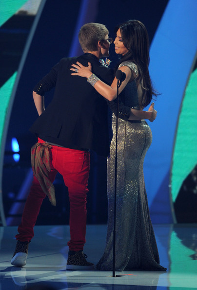 Kim Kardashian Singer Justin Bieber accepts the Best Male Video award from Kim Kardashian onstage during the 2011 MTV Video Music Awards at Nokia Theatre L.A. LIVE on August 28, 2011 in Los Angeles, California.