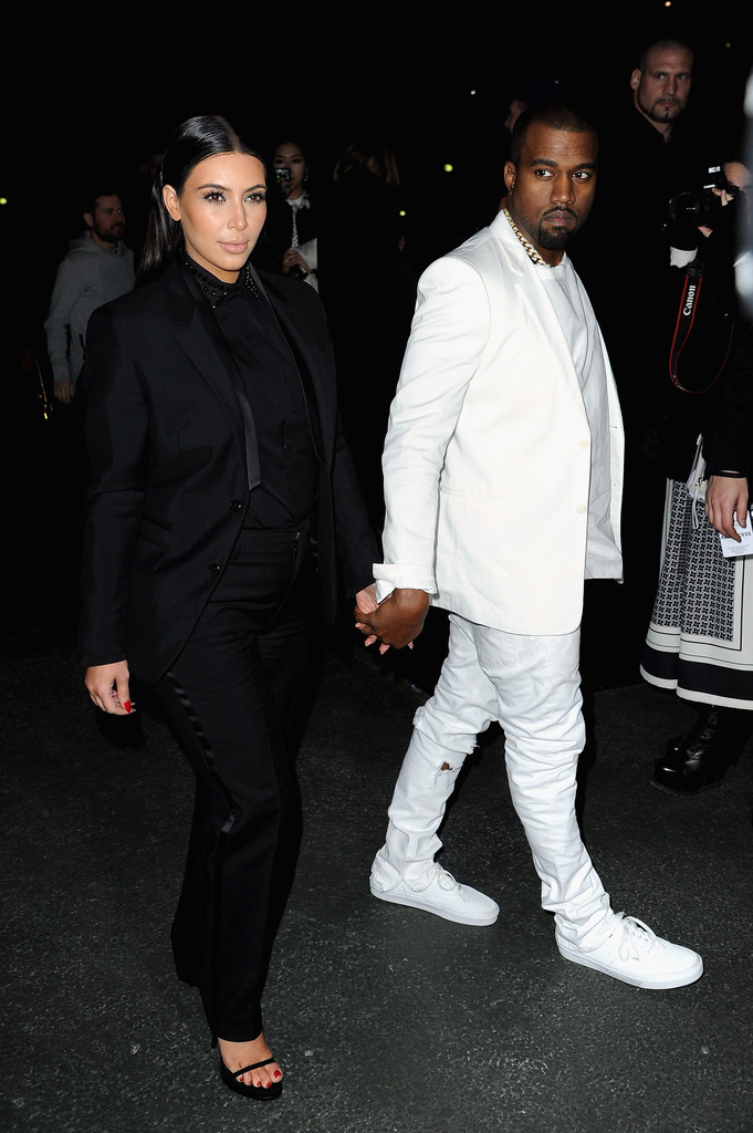 Kim Kardashian and Kanye West Wore Matching Pantsuits to Paris Fashion Week