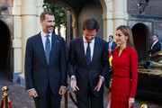 King Felipe VI (L) of Spain and Queen Letizia (R) of Spain are welcomed by Dutch Prime Minister Mark Rutte (C) at the Ministry of General Affairs with on October 15, 2014 in The Hague, Netherlands. Spain's royal couple are in the Netherlands for a one-day official visit.