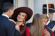 King Felipe VI of Spain (L) holds Queen Maxima of the Netherlands (2nd L) by her wrist as Queen Letizia (R) of Spain kisses King Willem-Alexander of the Netherlands goodbye at the end of their visit to Noordeinde palace on October 15, 2014 in The Hague, Netherlands. Spain's royal couple are in the Netherlands for a one-day official visit and will meet with Dutch Prime Minister Mark Rutte later today.