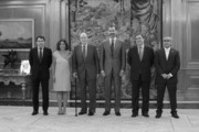 Image has been converted to black and white) King Juan Carlos of Spain (3L) and Prince Felipe of Spain (3R) receive Regional President Ignacio Gonzalez (L), Mayor of Madrid Ana Botella (2L), Secretary of State for Sport Miguel Cardenal (2R) and President of the Spanish Olympic Committee Alejandro Blanco (R) at the Zarzuela Palace on September 10, 2013 in Madrid, Spain.