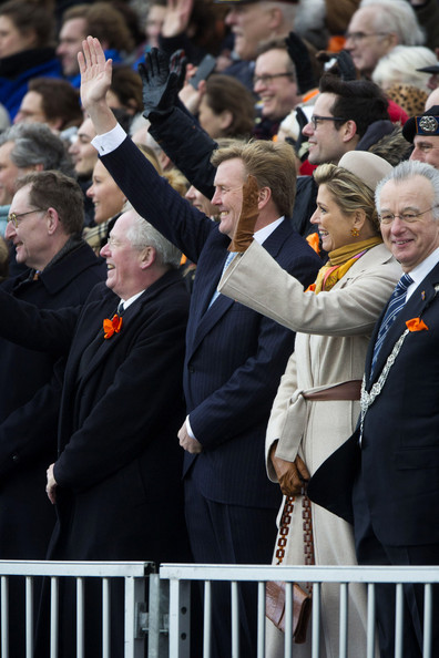 King Willem-Alexander of The Netherlands and Queen Maxima of The Netherlands watch a re-enactment of the landing on the beach of Prince Willem Frederik during the 200th anniversary of the kingdom of the Netherlands on November 30, 2013 in The Hague, Netherlands.