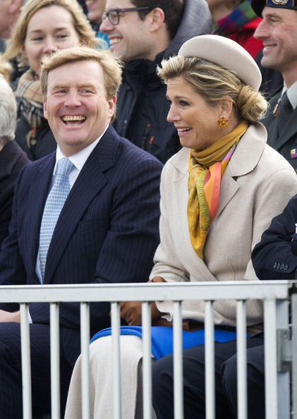 King Willem-Alexander of The Netherlands and Queen Maxima of The Netherlands watch a re-enactment of the landing on the beach of King Willem I during the 200th anniversary of the kingdom of the Netherlands on November 30, 2013 in The Hague, Netherlands.