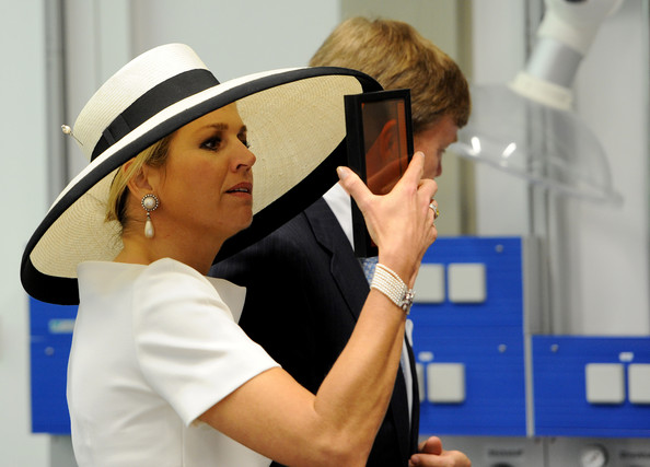 (L-R) Dutch King Willem-Alexander and Dutch Queen Maxima during their visit of the EWE research center's laboratory 'Next Energy' on May 26, 2014 in Oldenburg, Germany.