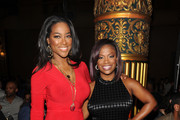 Kenya Moore and Kandi Burruss attend the Kithe Brewster fashion show during Mercedes-Benz Fashion Week Spring 2015 on September 11, 2014 in New York City.