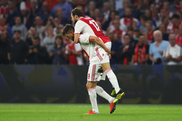 Ajax vs. Royal Standard De Liege - UEFA Champions League [player,sports,sports equipment,team sport,sport venue,ball game,football player,soccer,tournament,championship,daley blind,klaas-jan huntelaar,v,goal,ajax,royal standard de liege,uefa champions league,teams,match,game]