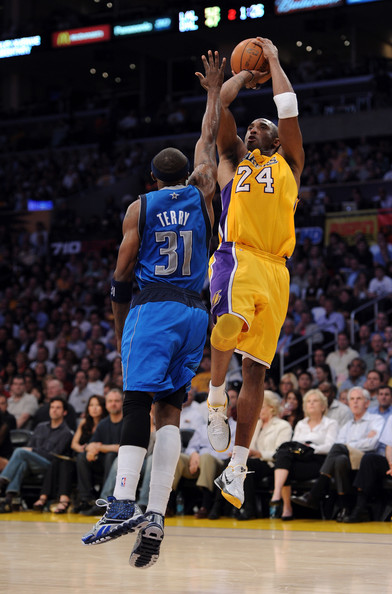 Kobe Bryant Kobe Bryant #24 of the Los Angeles Lakers shoots a jumper over Jason Terry #31 of the  Dallas Mavericks at Staples Center on March 31, 2011 in Los Angeles, California.  NOTE TO USER: User expressly acknowledges and agrees that, by downloading and or using this photograph, User is consenting to the terms and conditions of the Getty Images License Agreement.