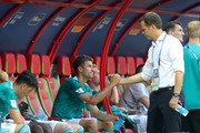 Oliver Bierhoff, team manager of Germany looks dejected with his player Thomas Mueller following her sides defeat in the 2018 FIFA World Cup Russia group F match between  Korea Republic and Germany at Kazan Arena on June 27, 2018 in Kazan, Russia.