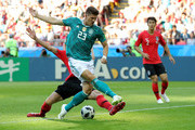 Youngsun Yun of Korea Republic tackles Mario Gomez of Germany  during the 2018 FIFA World Cup Russia group F match between Korea Republic and Germany at Kazan Arena on June 27, 2018 in Kazan, Russia.