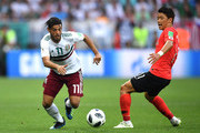 Carlos Vela of Mexico is challenged by Hwang Hee-chan of Korea Republic during the 2018 FIFA World Cup Russia group F match between Korea Republic and Mexico at Rostov Arena on June 23, 2018 in Rostov-on-Don, Russia.