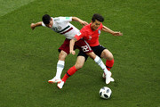 Hirving Lozano of Mexico tackles Yong Lee of Korea Republic  during the 2018 FIFA World Cup Russia group F match between Korea Republic and Mexico at Rostov Arena on June 23, 2018 in Rostov-on-Don, Russia.