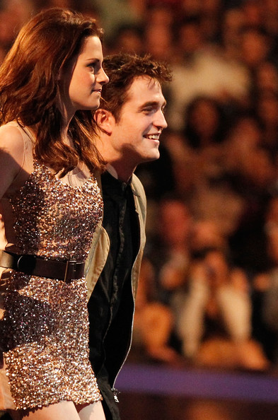 Kristen Stewart Actors Kristen Stewart (L) and Robert Pattinson accept the Favorite Movie award onstage during the 2011 People's Choice Awards at Nokia Theatre L.A. Live on January 5, 2011 in Los Angeles, California.
