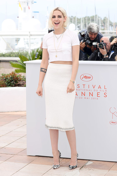 'Cafe Society' Photocall - The 69th Annual Cannes Film Festival [cafe society photocall,white,clothing,fashion model,lady,flooring,fashion,dress,trunk,cocktail dress,leg,kristen stewart,cannes,france,cannes film festival]