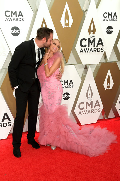The 53rd Annual CMA Awards - Arrivals [red carpet,carpet,flooring,red,dress,pink,gown,fashion,formal wear,event,arrivals,kristin chenoweth,josh bryant,cma awards,nashville,tennessee,music city center]