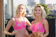 Kris Hallenga and Kristina Rhianoff attend a photocall to launch a Breast Cancer Awareness sports bra on October 9, 2012 in London, England.