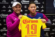 (L-R) Roberto Hernandez coach of Morelia and  Ray Sandoval pose with the jersey during a press conference to unvail Ray Sandoval at Morelos Stadium on January 03, in Morelia, Mexico.
