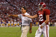 Quarterback Greg McElroy #12 and head coach Nick Saban of the Alabama Crimson Tide question an intentional grounding penalty that led to a safety for the Louisiana State University Tigers at Bryant-Denny Stadium on November 7, 2009 in Tuscaloosa, Alabama.