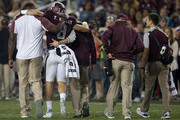 Trevor Knight #8 of the Texas A&M Aggies is helped off the field by training staff after an apparent knee injury in the fourth quarter against the LSU Tigers at Kyle Field on November 24, 2016 in College Station, Texas.