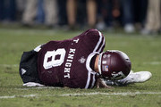 Trevor Knight #8 of the Texas A&M Aggies lays on the field with apparent knee injury against the LSU Tigers in the fourth quarter at Kyle Field on November 24, 2016 in College Station, Texas.