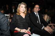 """(L-R) Catherine Deneuve and Nicolas Hieronimus attend the """"La French-Art Of Coloring"""" - 110th Anniversary of L'Oreal Professional At Carrousel Du Louvre on March 24, 2019 in Paris, France."""