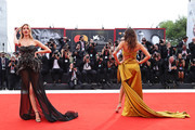 """Martha Hunt and Isabeli Fontana walk the red carpet ahead of the Opening Ceremony and the """"La Vérité"""" (The Truth) screening during the 76th Venice Film Festival at Sala Grande on August 28, 2019 in Venice, Italy."""