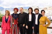"""(L-R) Flavia Gusmao, Barbara Santos, Director Karim Ainouz, Carol Duarte, Gregorio Duvivier and Julia Stockler attend the photocall for """"La Vie Invisible D'Euridice Gusmao"""" during the 72nd annual Cannes Film Festival on May 20, 2019 in Cannes, France."""
