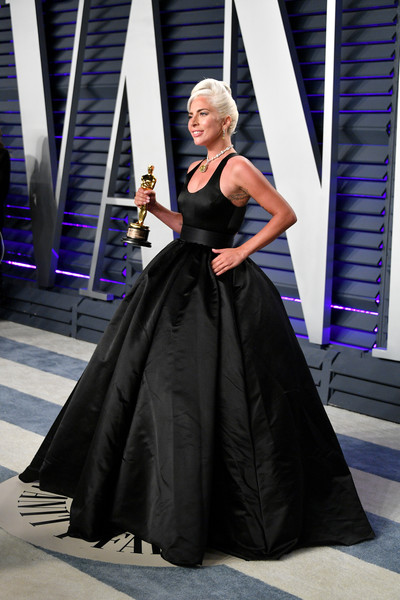 2019 Vanity Fair Oscar Party Hosted By Radhika Jones - Arrivals [original song,a star is born,clothing,dress,gown,fashion,fashion model,haute couture,formal wear,event,shoulder,fashion show,radhika jones - arrivals,winner,lady gaga,award,shallow,wallis annenberg center for the performing arts,oscar party,vanity fair]