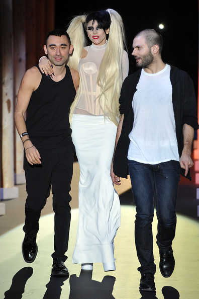 Lady Gaga Nicola Formichetti, Lady Gaga and Sebastian Peigne walk the runway during the Thierry Mugler Ready to Wear Autumn/Winter 2011/2012 show during Paris Fashion Week at Gymnase Japy on March 2, 2011 in Paris, France.