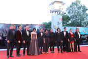 "(L-R) Tom Wlaschiha, Mark Chao, Pascal Greggory, Huang Xiangli, Songwen Zhang, Ma Yingli, director Lou Ye, Joe Odagiri, Ayumu Nakajima, Gong Li and Jean Michel Jarre walk the red carpet ahead of the ""Lan Xin Da Ju Yuan"" (Saturday Fiction) screening during the 76th Venice Film Festival at Sala Grande on September 04, 2019 in Venice, Italy."
