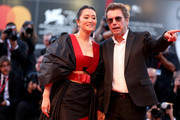 """Gong Li and Jean-Michel Jarre arrive on the red carpet ahead of the """"Lan Xin Da Ju Yuan"""" (Saturday Fiction) screening during the 76th Venice Film Festival at Sala Grande on September 04, 2019 in Venice, Italy."""