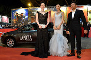 (L-R) Li Xiaoran, Qin Shupei and Su You Peng attend the 'Bullet To The Head' premiere during the 7th Rome Film Festival on November 14, 2012 in Rome, Italy.