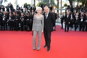 """French director Tonie Marshall (L) and French fashion designer Jean-Paul Gaultier pose as they arrive on May 15, 2016 for the screening of the film """"Mal de Pierres (From the Land of the Moon)"""" at the 69th Cannes Film Festival in Cannes, southern France.  / AFP / Valery HACHE"""