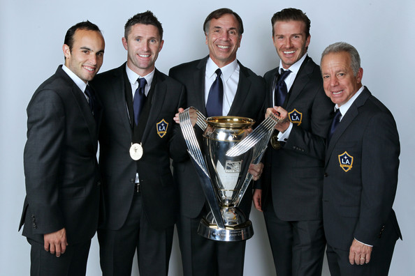 2011 MLS Cup - Portraits [portraits,landon donovan 10,team,suit,award,event,white-collar worker,formal wear,businessperson,trophy,dave sarachan,bruce arena,robbie keane,david beckham 23,l-r,home depot center,los angeles galaxy,mls cup]