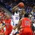 Tyshawn Taylor Photos - Tyshawn Taylor #10 of the Kansas Jayhawks drives between Jordin Mayes #20 and Kyle Fogg #21 of the Arizona Wildcats during the championship game of the Las Vegas Invitational at The Orleans Arena November 27, 2010 in Las Vegas, Nevada. - Las Vegas Invitational - Day Two
