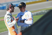 Daniel Suarez, driver of the #19 ARRIS Toyota, and Jamie McMurray, driver of the #1 GEARWRENCH Chevrolet, talk during qualifying for the Monster Energy NASCAR Series South Point Hotel and Casino 400 at Las Vegas Motor Speedway on September 14, 2018 in Las Vegas, Nevada.