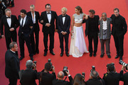 """(FromL) British actor Jared Harris, Spanish actor Javier Bardem, South African-US actress Charlize Theron, French actor Jean Reno, US actor Hopper Penn, French actress Adele Exarchopoulos, US actor and director Sean Penn, US actor Zubin Cooper and US producer Matt Palmieri pose as they arrive on May 20, 2016 for the screening of the film """"The Last Face"""" at the 69th Cannes Film Festival in Cannes, southern France.  / AFP / Antonin THUILLIER"""
