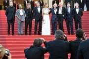 """(FromL) US producer Matt Palmieri, US actor Zubin Cooper, US actor and director Sean Penn, French actor Jean Reno, French actress Adele Exarchopoulos, Sean Penn's son Hopper Jack Penn, South African-US actress Charlize Theron, Spanish actor Javier Bardem and British actor Jared Harris as they arrive on May 20, 2016 for the screening of the film """"The Last Face"""" at the 69th Cannes Film Festival in Cannes, southern France.  / AFP / ALBERTO PIZZOLI"""