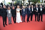 """(FromL) US producer Matt Palmieri, US actor Zubin Cooper, US actor and director Sean Penn, French actress Adele Exarchopoulos, Sean Penn's son Hopper Jack Penn, Spanish actor Javier Bardem, South African-US actress Charlize Theron, French actor Jean Reno and British actor Jared Harris  on May 20, 2016 for the screening of the film """"The Last Face"""" at the 69th Cannes Film Festival in Cannes, southern France.  / AFP / ALBERTO PIZZOLI"""