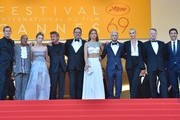 """(FromL) US producer Matt Palmieri, US actor Zubin Cooper, US actress Dylan Penn, US actor and director Sean Penn, French actor Jean Reno, French actress Adele Exarchopoulos, US actor Hopper Penn, South African-US actress Charlize Theron, British actor Jared Harris and Spanish actor Javier Bardem pose as they arrive on May 20, 2016 for the screening of the film """"The Last Face"""" at the 69th Cannes Film Festival in Cannes, southern France.  / AFP / LOIC VENANCE"""