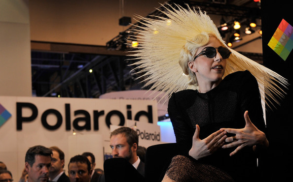 Singer Lady Gaga during an announcement of Lady Gaga's long term partnership with Polaroid as the brand's creative director on a speciality line of imaging products at the 2010 International Consumer Electronics Show at the Las Vegas Convention Center January 7, 2010 in Las Vegas, Nevada. CES, the world's largest annual consumer technology tradeshow, runs through January 10 and is expected to feature 2,500 exhibitors showing off their latest products and services to about 110,000 attendees.
