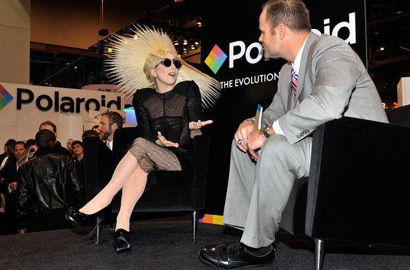 Singer Lady Gaga (L) with John Pollock, chief marketing officer of Polaroid during an announcement of Lady Gaga's long term partnership with Polaroid as the brand's creative director on a specialty line of imaging products at the 2010 International Consumer Electronics Show at the Las Vegas Convention Center January 7, 2010 in Las Vegas, Nevada. CES, the world's largest annual consumer technology tradeshow, runs through January 10 and is expected to feature 2,500 exhibitors showing off their latest products and services to about 110,000 attendees.