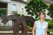 """Alma Jodorowsky poses at the launch of """"Les Eaux De Chanel"""" Photocall at the Hippodrome de Clairefontaine on June 7, 2018 in Deauville, France."""