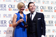 Marianne Elliott with her Best Director award with presenter Lee Evans during The Laurence Olivier Awards at the Royal Opera House on April 28, 2013 in London, England.